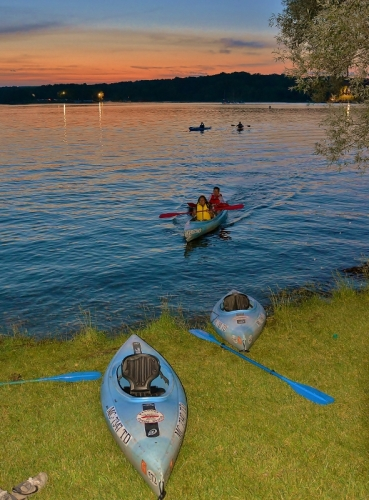 Canoes and Kayaks return to North Martindale Beach as the sun sets and music fades - photo by Michael Dwyer